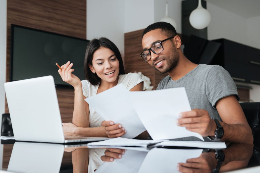 A couple reading refinancing documents