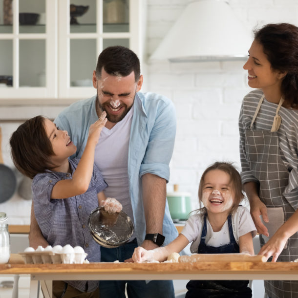 A family having fun in the kitchen
